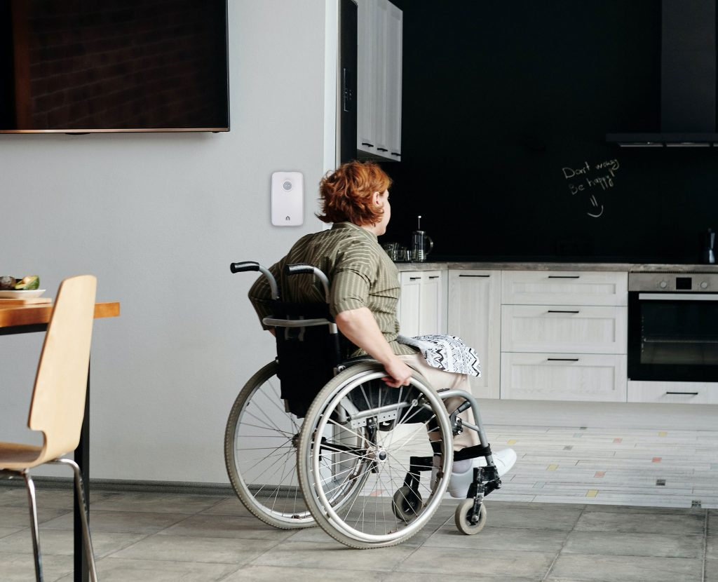 Woman in a wheelchair at home with Vox I.C.E | Vox In Case of Emergency | Monitoring Technology | Vox IoT | image