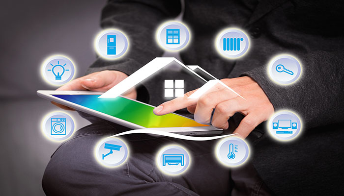 Man sitting with iPad on his lap surrounded by smart home icons | Vox Wi-Fi Home | Vox Wi-Fi 6Home Mesh| image